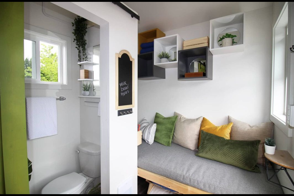 Little house comes with built-in bed and mattress, with storage.| Dwelltech