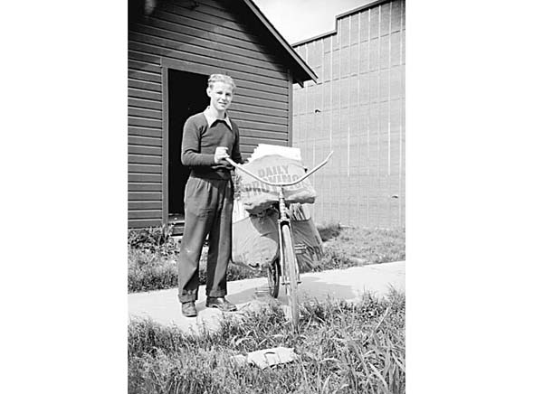 1940s - A Province newspaper delivery boy poses with his delivery bike.